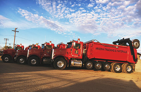 Arizona Trucking & Materials offers large truck rentals to move your rocks, sand, gravel or other landscaping materials. Our truck rental options range from flat bed trucks to large, 18-wheel, 25-ton dump trucks.
