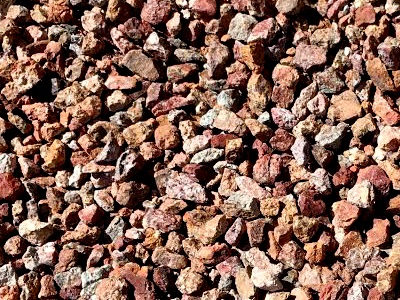 Arizona Sunset is granite that is naturally brown in color with a unique blend of gold, copper and caramel tones which make it perfect for accenting areas around other rock gardens or use in large outdoor concrete planters. It comes pre-screened in four different sizes. At Arizona Trucking & Materials, we offer a large selection of landscape rocks, flagstone and other organic materials.