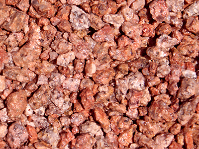 Yavapai Coral Tucson Landscape Rocks Decorative rocks is granite that is naturally pink in color with a unique blend of rose, peach and salmon tones which make it perfect for accenting areas around other rock gardens or use in large outdoor concrete planters. It comes pre-screened in three different sizes. At Arizona Trucking & Materials, we offer a large selection of Tucson landscape rock, flagstone and other organic materials.